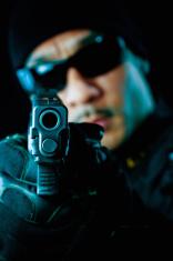SWAT officer pointing gun