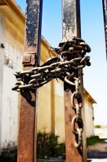 Rusty gates chained and tied with wire
