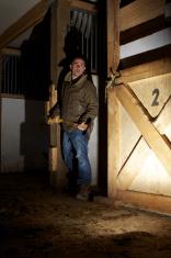 Man holding axe in barn