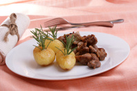 some grilled goulash and organic herbed potato