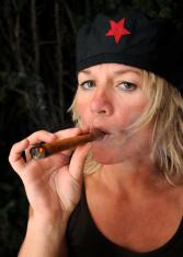 Blonde woman smoking Cuban cigar