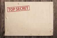 Open top secret envelope on table.
