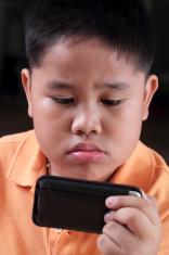 boy playing gadgets