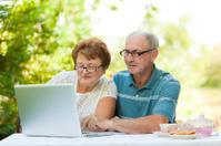 Happy senior couple browsing internet