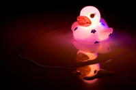 Glowing Bath Time Rubber Duck on Dark Background