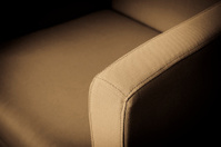 Hotel sofa couch in sepia light with vignetting