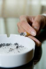Girl holding a cigarette