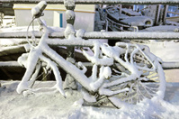 Bike covered with snow in Amsterdam the Netherlands