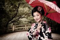 Japanese Woman in Kimono and Zen Garden