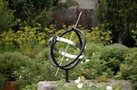 abstract statue as sun clock in garden