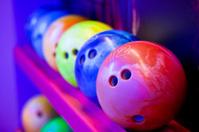Bowling balls on ball shelves