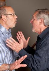Two senior men arguing