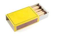 Matches in a matchbox on white background with copy space