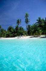 Maldives, southern atolls, surfers.