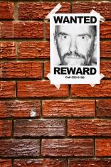 """Wanted"" poster with mug shot of wild eyed man"