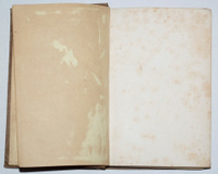 Old worn open stained book