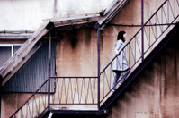 Girl walking up staircase