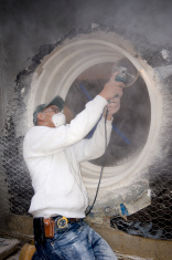 stone mason using a grinder