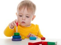 Boy playing pyramid