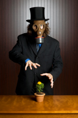 man wearing a gas mask with flower