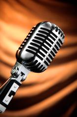 Vintage Microphone Against a Orange Curtain