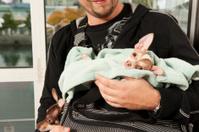 Man holding baby Chihuahuas