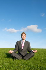 Businessman Meditates in Bright Meadow