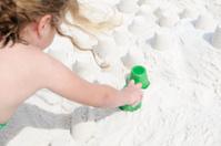Girl building sand castle on beach