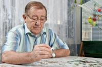 Senior man assembling a puzzle
