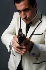 Classy male Secret Agent Pointing A Gun