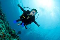 scuba diver swims to the camera