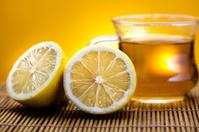 Glass cup of tea with lemon