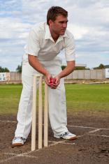 Cricket player behind stumps