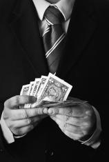 Man counts money