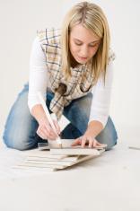 Home improvement - handywoman measuring tile