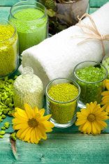 Aromatherapy - bath salt, flowers and towel
