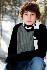 head and shoulders of teen boy outdoors