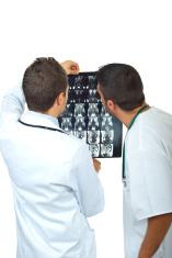 Two doctors men examine magnetic resonance