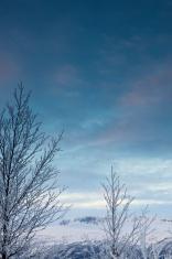 Sunrise at Geilo ski resort in Norwegian mountains in December