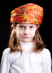Little girl in turban making a mad face