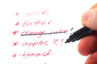 shopping list with pen and hand