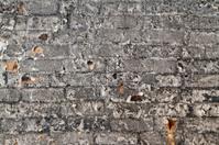 Burned wall of bricks