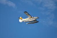 Flying seaplane in a blue sky