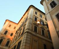 Roman street corners with streetlight at dusk, Rome Italy