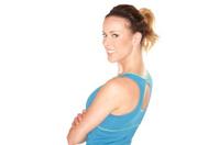 Portrait of beautiful fitness model on white