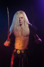 Long haired viking warrior with two swords