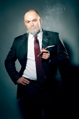 Dramatic Portrait of Cigar Smoker