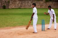 Young Sri Lankan schoolboys playing cricket