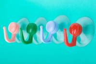 plastic hook on green macro