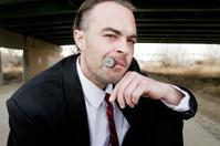 Menacing Man Under Bridge Smoking Cigar